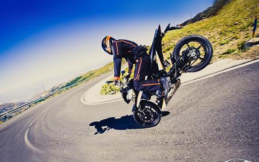 fondo de motociclista haciendo stunt